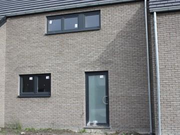 De bouw van drie nieuwbouwwoningen. Leffinge/Oostende